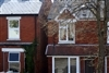 House prices 7% higher than year before, despite monthly drop